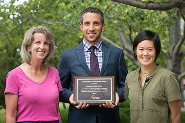 Shown with the CACME award are Pearlanne Zelarney, MS from Research Informatics Services, Matthew Stern from The Office of Professional Education, and Dr. Darlene Kim, program co-chair.