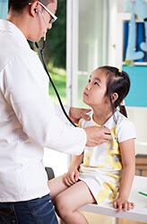 A doctor conducting research for a pediatric clinical trial