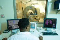 Man monitoring a CT scan