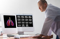 Doctor reviewing lung images on computer
