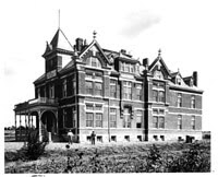 The original hospital building was completed in 1893, but due to a nationwide recession, it did not open until 1899.