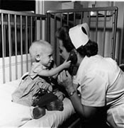 A nurse providing care to a pediatric patient.