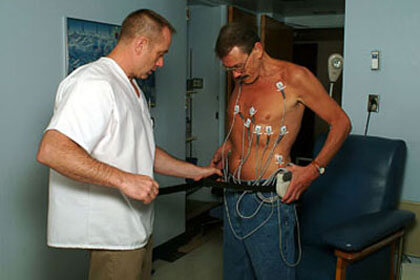 EKG leads are placed to monitor the heart during exercise.