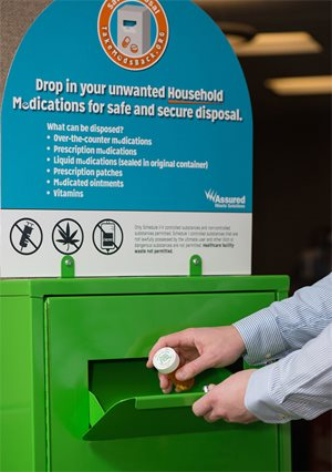 At National Jewish Health, look for the bright green medication drop-box across from the National Jewish Health pharmacy, which is located near the main entrance.